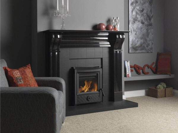 Esse 301 SE - Typical of ESSE's innovative thinking, these two convector stoves represent a unique solution to fireplace conversion – replacing an inefficient open fire with continuous controlled warmth, coupled to exceptional fuel economy. ESSE pioneered convector stoves back in the 1920s, and we've been further developing the technology ever since.  Both these models feature a heat exchange convection chamber, with the firebox sitting inside a second outer casing with a cavity between the two. Cool air from the room is drawn in at the base of the stove and heated before rising out of the top of the stove into the room, keeping the mantle cooler.