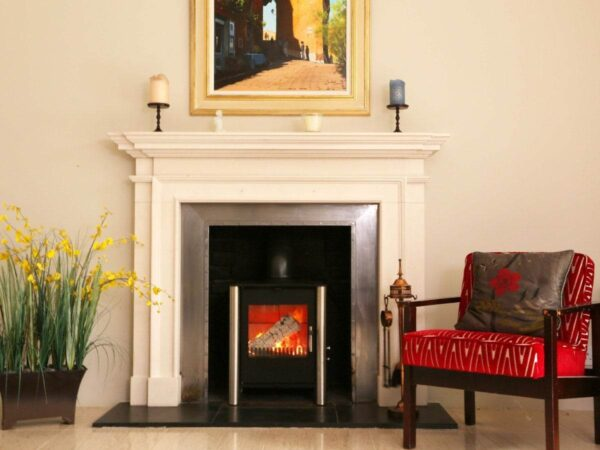 Esse 525 SE Stove - If we say ourselves, this stove is a stunning piece of contemporary design ? combining the timelessly comforting appeal of a traditional British-built wood-burner with stripped down, minimalist, almost Scandinavian styling. With its ?cubist? flame-box view, and highly distinctive cylindrical pillar design, this really is an exceptionally eye-catching stove, even for an ESSE. And you can choose whether you prefer the pillared legs in black, to match the stove body, or in contrasting stainless steel. In terms of performance, its footprint and energy-efficient 5kW heat output make it ideally suited to almost any living room ? whether rustic or urban, as it?s approved for use in smoke control areas. To make it as easy to use as it is on the eye, our Esse 525 SE Stove model features primary and secondary air control sliders, as well as a twin position riddling grate with both wood and mineral fuel settings. It can be installed with either a top or rear flue. And there?s one other ESSE option well worth a mention: if you prefer warmth that?s instantly controllable at the touch of a button, just choose the gas version of the 525 ? which can even be installed without a flue, and positioned almost anywhere.