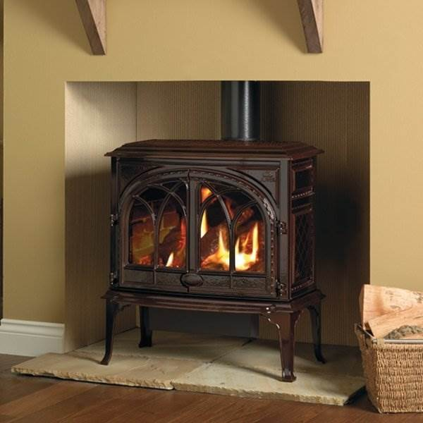 Jotul GF400 - The Jøtul GF 400 CFpresents the perfect union of high efficiency and cast iron beauty. Its classic lines and Gothic arch double doors frame a hand crafted log set. Completed with flames and glowing embers that give the Jøtul GF 400 CF unrivalled realism within the gas stove industry.