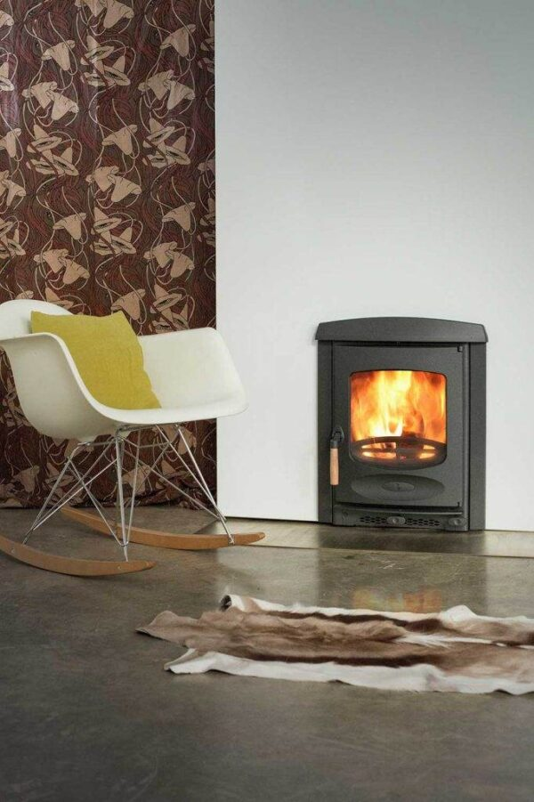 """Charnwood C-Four Insert - <h6 class=""""frutiger-bold"""">Based on the free standing C-Four this stove is designed to fit into a standard fireplace. Featuring a single air control and an integrated outlet for ducting external air the C-Four Insert burns exceptionally clean with outstanding efficiency. This stove also features our renowned converting grate for efficient multi fuel burning and meets the DEFRA requirements for smoke control exemption; allowing wood to be burnt in smoke control areas.</h6>"""