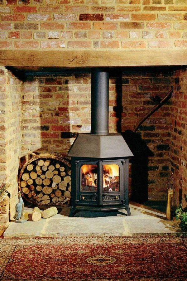 """Charnwood Country 12 - The Country 12 is the largest in our Country room heater range. With a rated output of 12kW it is well suited to a larger room or an open plan area. It blazes with superb, clean-burn, efficiency coupled with minimum mess, leaving your home thoroughly warmed. It takes a large log size of up to 430mm (17""""). The options of a slide-on canopy, back-boiler, drop-in riddling grate and choice of colours all apply. As with all the stoves in the Country range the 12 is built from a substantial combination of the best materials and enhanced with touches of solid brass."""