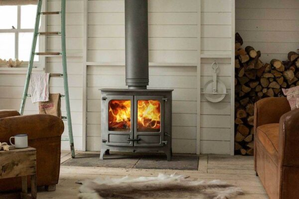 Charnwood Island IIIB - The Island IIIb wood burning boiler stove is the ultimate in biomass heating. Equipped with the renowned Charnwood converting grate for easy ash removal and fully boiler sensitive thermostatically controlled the Island IIIb combines leading edge boiler technology with its exceptional aesthetic design. As an integral boiler stove it is optimised to heat between 6 and 9 radiators plus hot water ensuring exceptional performance. It has a total output of 18kW and also features the 'cool to touch' handle and has the ability to burn logs up to 550mm.