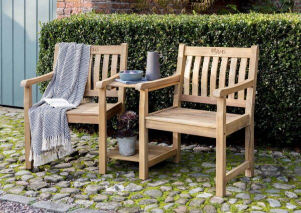 """RHS Chelsea Companion Set - <span style=""""float: none; background-color: #ffffff; color: #3a3a3a; cursor: text; font-family: Georgia,'Times New Roman','Bitstream Charter',Times,serif; font-size: 100%; font-style: inherit; font-variant: normal; font-weight: inherit; letter-spacing: normal; text-align: left; text-decoration: none; text-indent: 0px; text-transform: none;"""">The luxurious RHS Chelsea range is made from natural eucalyptus wood with a hand coated teak oil finish. Traditional in style, the RHS Chelsea seating is made for garden lovers. Expect high-quality in every little detail.</span>"""