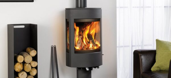 """Dovre Astroline 4 - With similar looks to the<a href=""""https://dovre.co.uk/appliance/astroline-3-wood-stoves/"""">Astroline 3 stove</a>, the Astroline 4 cast iron stove is also available in either wood burning or multi-fuel versions and with a choice of pedestal or wood store bases."""