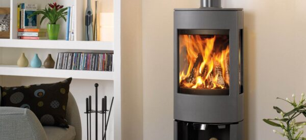 """Dovre Astroline 4 - With similar looks to the?<a href=""""https://dovre.co.uk/appliance/astroline-3-wood-stoves/"""">Astroline 3 stove</a>, the Astroline 4 cast iron stove is also available in either wood burning or multi-fuel versions and with a choice of pedestal or wood store bases."""