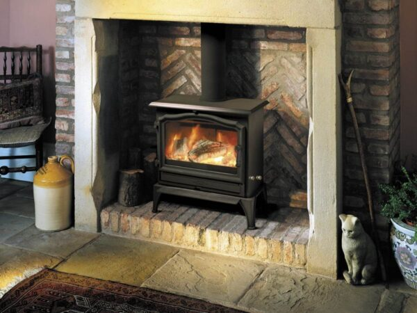 Esse 100 SE - One of our very best sellers, this beautiful stove embodies everything that people love about ESSE wood-burners, on a relatively small scale. Built wide and slim, it's the perfect choice for style and warmth if your hearth depth is on the limited side. It may not be one of our bigger models, but the clean-burning 100 has all the presence of a classic ESSE stove – with our signature VISA door arch styling, and a large window enabling you to enjoy a landscape view of your fire.