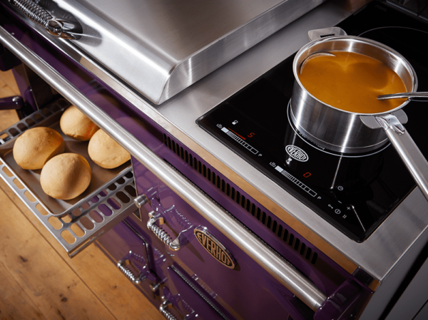 "Everhot 100i - The Everhot 100i is equipped with a two zone induction hob, fitted neatly under the second lid. With fingertip controls and incredible speed and control, it is a modern addition to your classic range cooker. The warming oven on this model is behind the bottom right door. Click <a href=""https://www.topstak.co.uk/events/"">here</a> for a list of upcoming cooking demonstrations"