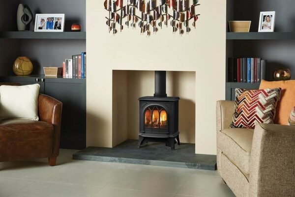 """Gazco Huntingdon 20 Gas - The compact Gazco Huntingdon 20 gas stove's proportions make it perfect for British fireplace openings, whilst its highly efficient 2.6kW heat output easily creates a warming atmosphere in standard sized rooms. Producing dancing flames over a realistic log fuel bed, this stove is offered with Standard and<a href=""""https://www.stovax.com/appliance/stoves/gas-stoves/buying-gas-stove/gas-stoves/command-remote-controls-for-stoves/"""">Programmable Thermostatic remote controls</a>, providing real fire ambience at the touch of a button."""