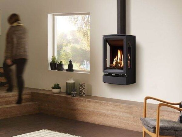 Gazco Midi T Wall Mounted - For an alternative installation to the standard and Midline versions, the Gazco Midi T Wall Mounted gas stove makes for a strikingly contemporary statement. This floating installation can be either rear or top flued depending on your preferences and is available as a balanced flue model only.  All Vogue Midi T models can be upgraded with a remote control allowing you to adjust the flames and heat without leaving your armchair. There is also the option of a Programmable Thermostatic handset, which allows you to preset your stove to turn on at specific times and temperatures.