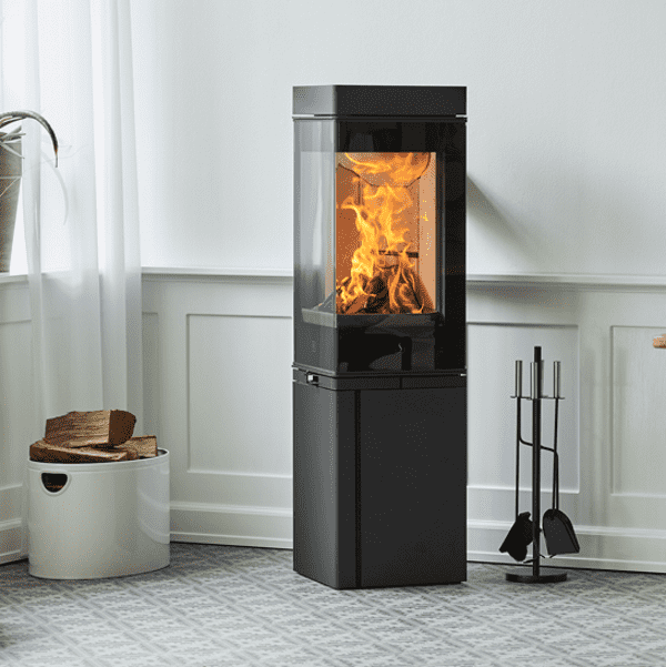 Scan 80 Series - Like a basalt column hiding a glowing lava, the Scan 80 provides a beautiful 180 degree view of the flames through a prismatic glass. Scan 80 is perfectly suitable for a corner installation. In the best tradition of Danish design, the handle is beautifully integrated in the stove to provide a clean and slender line. The tall version of Scan 80 can accommodate heat accumulating stones which will provide warmth up to 12 hours after loading the last logs.