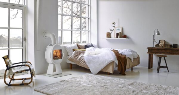 Scan 66 Series - The organic shape of Scan 66 creates a beautiful frame around the fire, and the view to the flames is maximized through the use of glass in the log retainer. Hang it on the wall or choose between different base options.
