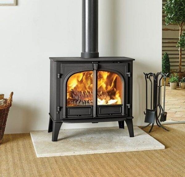 Stovax Stockton 11 - With an impressive 11kW heat output, the Stockton 11 wood burning and multi-fuel stove is one of the largest in the Stovax's Stockton range and is particularly suitable for sizeable living rooms, substantial inglenooks and open-plan barn conversions. The choice of flat top, low or high canopy, single or double door versions and four colour options, will provide you with the perfect combination for your home. The Stockton 11 is available as a dedicated woodburner which can be easily adapted to multi-fuel use with the optional riddling grate kit.