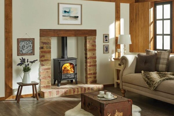 """Stovax Stockton 5 - The Stovax Stockton 5 stove offers you a mid-sized stove that is larger than the<a href=""""https://www.stovax.com/stockton-3/"""">Stockton 3</a>or<a href=""""https://www.stovax.com/stockton-4/"""">Stockton 4</a>, and is available as either a wood burning stove or as a multi-fuel model with external riddling. The additional width allows you to load up to 13″ (330mm) in length.  The Stockton 5 model is available as a<a title=""""Stockton 5 gas stove"""" href=""""https://www.stovax.com/stockton-gas-stoves/stockton-5-gas-stoves/"""">gas stove</a>."""
