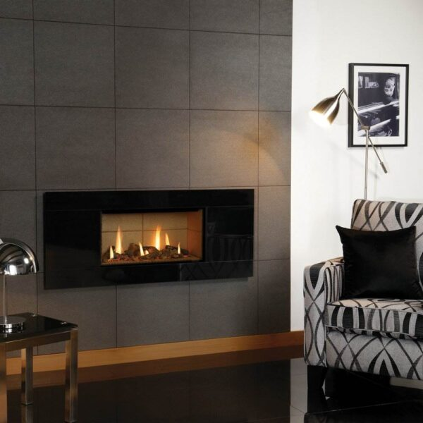 Gazco Studio 1 - The Gazco Studio gas fire is for those who require minimalist modern perfection. This gas fire has an eye-catching no-frame* design which realises that 'hole-in-the-wall' fire look. Available as both Glass Fronted and Open Fronted models, this contemporary fire adds a stylish statement to any living space. Glass Fronted models benefit from a choice of three realistic fuel beds: Log-effect, Pebble & Stones or Driftwood-effect for that beachy aesthetic. Furthermore, Open Fronted models can have the White Stones fuel bed upgraded to red, black or clear Glass Beads which, next to the ribbon of flames, creates quite the spectacular centrepiece.
