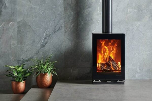 """Stovax Vision Midi T - The Stovax Vision Midi T wood burning stove offers a taller version of the<a href=""""https://www.stovax.com/stove-fire/vision-wood-multi-fuel-stoves/vision-midi/"""">Midi</a>for a more expansive flame picture. This wood burning model features one of the most advanced Cleanburn combustion systems available, making it an exceptionally environmentally friendly stove option.  All models in the Vision range can be enhanced with a matching ceramic glass top, glass plinth as well as a gloss flue pipe if desired."""