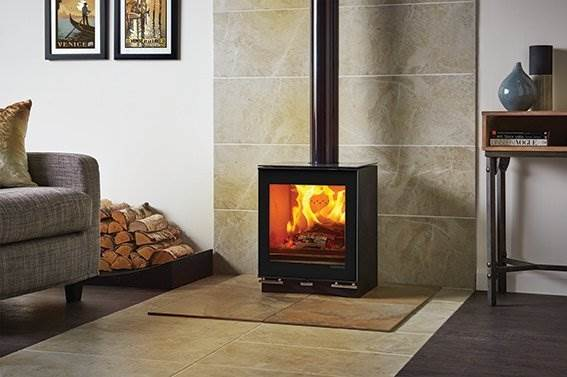 Stovax Vision Midi - Featuring the same clean, geometric form and reflective detailing, the Stovax Vision Midi stove offers an impressive heat output of up to 6.5kW.  Available in wood burning or multi-fuel models, the Vision Midi stove offers many optional extras including the external air kit allowing air to be drawn from the outside, minimising drafts in your room as well as a gloss black flue pipe to really personalise your stove.