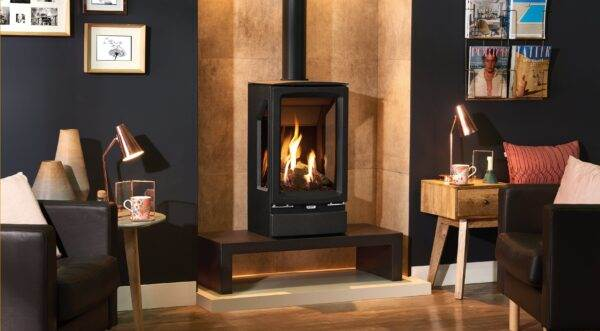 Gazco Midi T - The versatile Gazco Vogue Midi T gas stove range provides stunning flames and a high efficiency heat output of up to 84%. Taking the elegant styling of the smaller Midi range, the Midi T's bevelled cast iron exterior encases a taller firebox that offers a three-sided view of the impressive visuals.  Vogue Midi T stoves feature a highly realistic log-effect fuel bed which is reflected on multiple sides by Gazco's EchoFlame Black Glass interior. Each ceramic log is positioned to create varied and natural flames almost indistinguishable from a real wood burning fire.