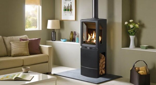 Gazco Midi T Highline - The versatile Gazco Vogue Midi T gas stove range provides stunning flames and a high efficiency heat output of up to 84%. Taking the elegant styling of the smaller Midi range, the Midi T's bevelled cast iron exterior encases a taller firebox that offers a three-sided view of the impressive visuals.  Vogue Midi T stoves feature a highly realistic log-effect fuel bed which is reflected on multiple sides by Gazco's EchoFlame Black Glass interior. Each ceramic log is positioned to create varied and natural flames almost indistinguishable from a real wood burning fire.