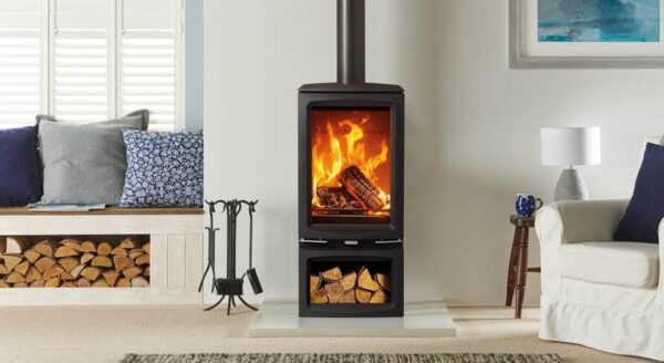 """Stovax Vogue Midi T - The Stovax Vogue Midi T is a taller version of the?<a href=""""https://www.stovax.com/stove-fire/vogue-wood-burning-stoves/vogue-midi-t/"""">Vogue Midi wood burning stove</a>, offering the same ultra cleanburn capability of the Midi, but featuring a more portrait firebox. Displaying superb visuals through the large stove window, the powerful Airwash system ensures the flames can always be appreciated. The Midi T can be installed with the Midline log store base for convenient fuel storage and increased height."""