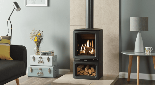 Gazco Midi Midline - Elegantly styled to fit equally well in either contemporary or traditional settings alike, the Gazco Vogue Midi gas stoves feature a cast iron door and top plate with refined curves and bevelled edges. For increased presence, Midline models are mounted on a matching log store base that can be used to house chopped logs to add to the woodburning aesthetic.