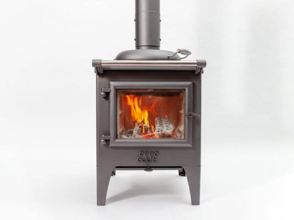 Esse Warmheart - The compact Warmheart wood-fired cooking stove is the perfect heating solution for a bijou country cottage or remote backcountry bothy. While its rugged cast-iron design and simple styling may give the impression that the Warmheart has been around for decades, this state-of-the-art piece of quality British engineering encapsulates everything we've learned in more than 160 years of manufacturing stoves and range cookers.  Using the same principles as our best-selling Ironheart, the wood-fired Warmheart provides ample heat to keep things warm and toasty while a casserole bubbles away on the hob or a couple of steaks sizzle in the firebox. No gas or electricity? No problem. The Warmheart comes into its own in an off-grid environment, making it the perfect choice for heating a bolt hole in the outback or a cabin in the woods.