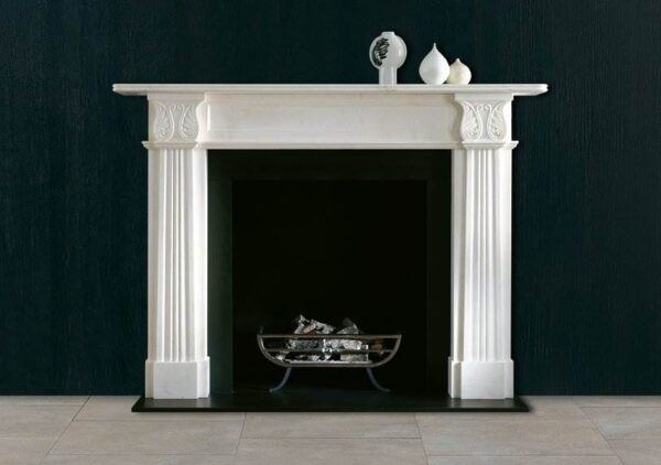 The Acanthus - A new version of this perennially popular Regency design. Carved in statuary marble with long elegant tapering jambs terminating in stiff leaf acanthus corner blocks, fielded frieze panel surmounted by a reeded mantle she
