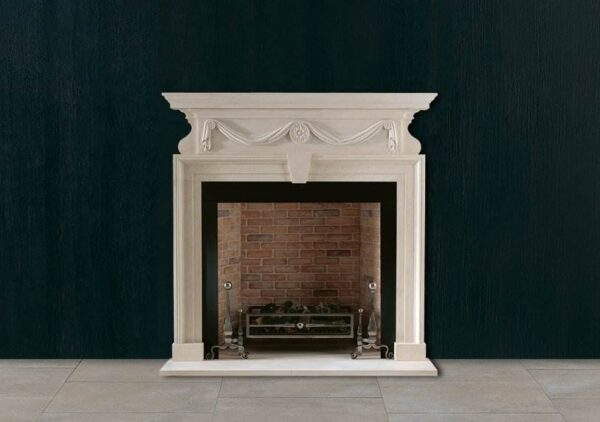The Brettingham - An early 18th century Limestone chimneypiece with an architrave moulding with central keystone beneath a frieze with robustly carved swags of drapery suspended from medallions.
