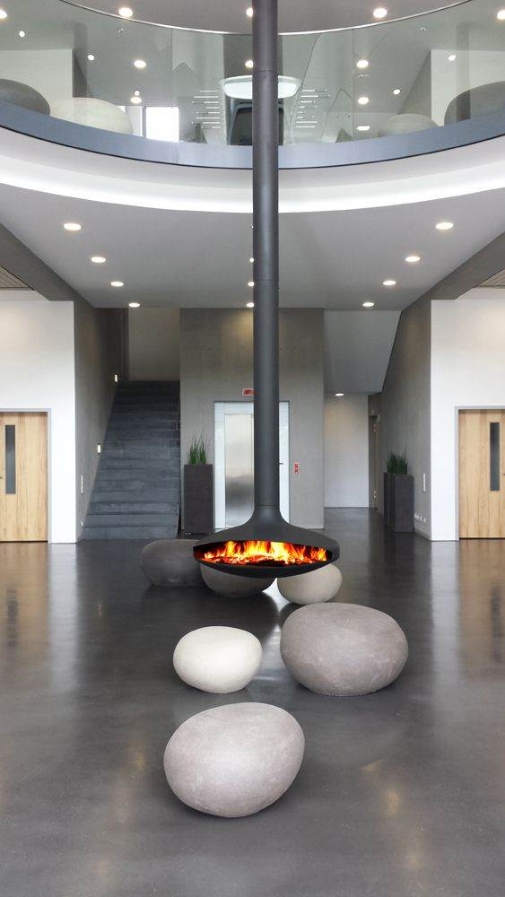 Gyrofocus - This seminal design, created by Dominique Imbert in 1968, was the first suspended, 360° pivoting fireplace. It was revolutionary as much for its technical design as its groundbreaking style.Its ease of installation, made-to-measure flue and its heat efficiency have all contributed to make this fireplace the signature model and symbol of Focus.
