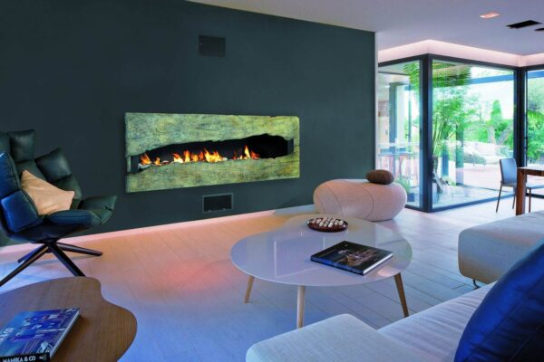 Metafocus 8 - A fireplace with a large steel firebox and a bronze sliding panel. Each unique façade is numbered and signed by Dominique Imbert.
