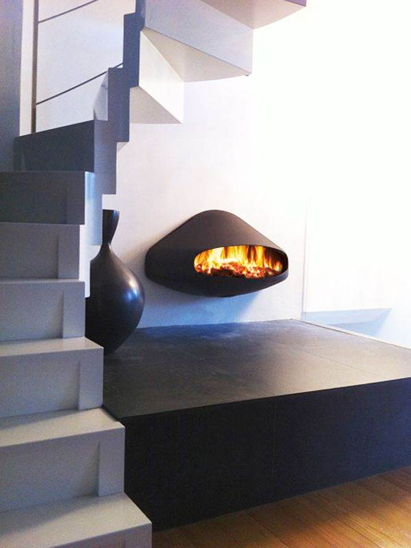 Miofocus - The Miofocus is a wall-mounted wood-burning fireplace with a hidden flue that channels the smoke out from a vent behind the hearth. Its soft shape occupies little space while its smiling mouth provides warm-hearted flames or fiery kisses on demand.