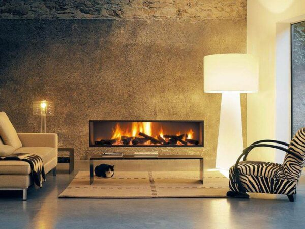 Neofocus - The Neofocus widens the horizon of fire, letting the flames seek their liberty.  This fireplace's talent lies in enlivening the flatness of a wall. In both its versions, wood-burning or gas-burning, and two different widths, this model has taken a prize position in our range.