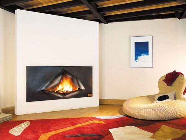 Omegafocus - In its challenge to unoriginal interior spaces, the Omegafocus is a celebration of art and function. This high-performance fireplace with low CO output is transformed to an arresting sculpture by a façade of ripped steel, ingeniously linking creativity and comfort.