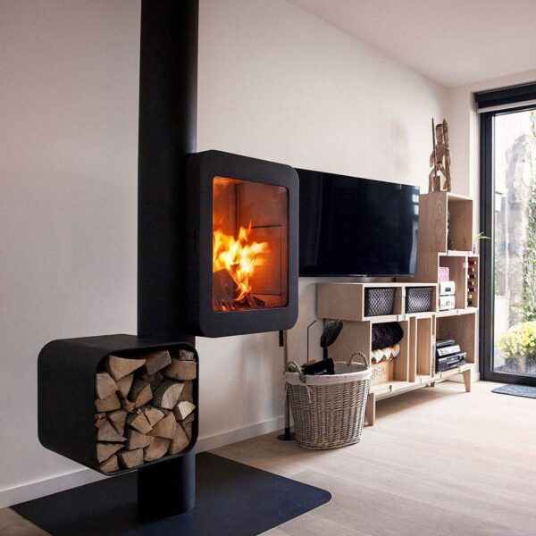 Grappus - Grappus is more than a wood stove: it is a composition that rhythmically structures space, giving the fire the high note. The height of the hearth, counterbalanced by the offset wood rack, makes the stove easy to use and adapts well to any space. Grappus successfully cross-fertilises a high-performance stove, a contemporary design that reveals the flames in all their splendour, and an easily accessible wood rack.