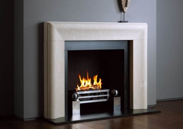 The Chelsea - The Chelsea modern fireplace reinvents the traditional bolection shape, refining it into a minimalist silhouette suited to contemporary tastes. With a single sweep of moulding, this stone fireplace adds movement to any interior without compromising the beauty of its surroundings. Smooth finishing and balanced proportions elevate this fire surround far beyond the simplicity of its design. Polished and refined, The Chelsea sits comfortably in most rooms, beautifully paired with a classic open fire.