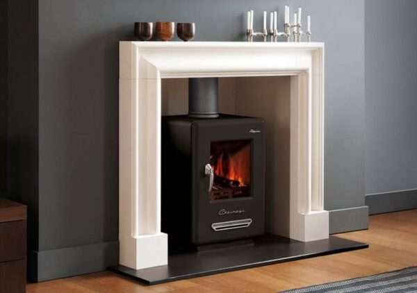 """The Clandon Bolection Frame - For a contemporary fireplace that errs on the side of traditional, choose The Clandon Bolection. A fine example of bolection moulding popularised by Christopher Wren in the 17th century, delicate proportions and soft architectural curves are its standout features. Carved from crisp limestone, this elegant white fire surround is an ideal choice for contemporary interiors in need of a sophisticated centrepiece. Couple with a<a href=""""https://www.chesneys.co.uk/products/stoves/wood-burning"""">wood burning stove</a>for the perfect fireside aesthetic."""