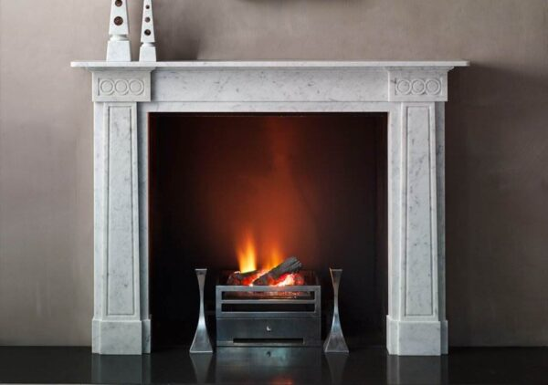 The Cosmopolitan - The Cosmopolitan pays homage to the work of Sir John Soane with its modern rendition of inversely tapering pilasters and guilloche ornamented corner blocks combining to create a mantel of an entirely contemporary nature.