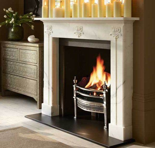 The Hulanicki Arc Nouveau - The Hulanicki Art Nouveau surround is carved in Statuary marble to allow the carver to work in the material best suited to capture in crisp detail the sinuous floral carving that characterises this delicate fireplace.