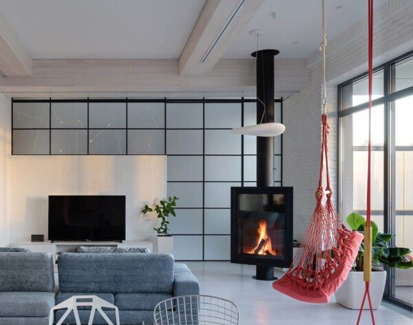 "Eurofocs 951 - Audacious yet sober, this expansive fireplace proudly displays its flames in their full splendour. This model is enhanced whether placed centrally in a room, in a corner or against a flat wall. It won the ""Mercure du Design"" award in Paris."