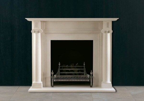 The Fairfax - An early 19th century limestone chimneypiece of strong and simple design featuring engaged ionic columns and plain fields to the corner blockings and entablature.