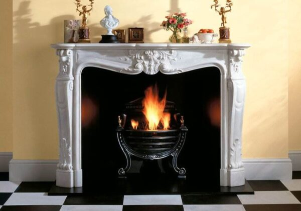 The Versailles - Sensuous curves and shapely mouldings characterise the Versailles fireplace. Rarely showing a straight line or a sharp corner its exuberant design is a magnificent example of Chesneys carving.