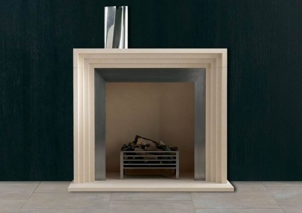 The Gaumont - For a modern fireplace that captures the essence of Art Deco design, look no further than The Gaumont. Elegant in its simplicity, the receding rectangles and strong linear design of this piece reflect the geometric silhouettes made popular during the period. Bringing a touch of 1920s decadence to the 21st century, The Gaumont is a dazzling centrepiece, capturing the attention of any room. Impeccably carved from smooth limestone, this contemporary fire surround will truly stand the test of time.