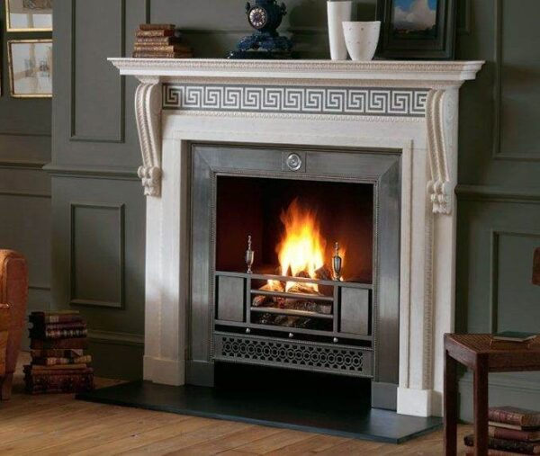 The Chillington - A handsome Georgian chimneypiece that displays the popular 18th century device of inlaying a contrasting marble within a statuary marble field. It has a carved corniced mantel shelf above a 'running' frieze with a Greek Key Azul Valverde inlay and jambs that terminate in delicately carved consoles.