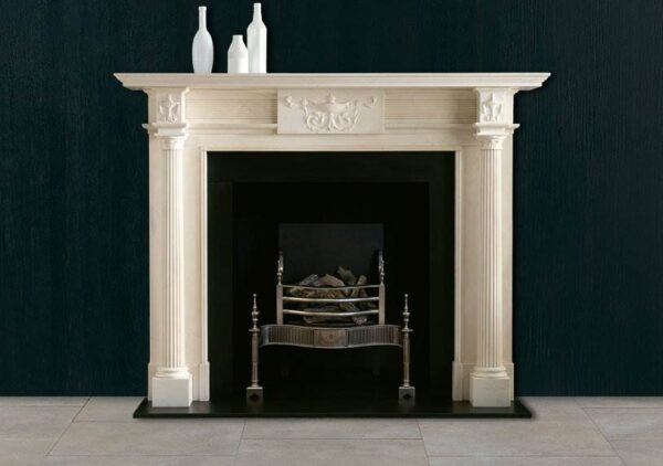 The Hartwell - An early 19th century chimneypiece in statuary marble with detached reeded columns terminating in finely carved capital mouldings beneath corner blocks displaying classical urns to match the carved centre tablet.