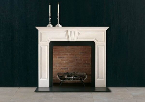 The Harwood - A Limestone chimneypiece of early 18th century design with incised panels and a central keystone very often found in panelled rooms.