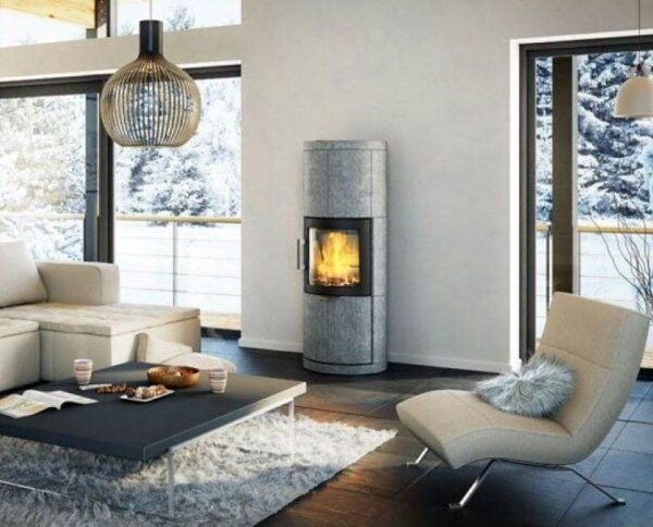 Hwam 7150 - The round stove is clad with soapstone from top to bottom and all the way round. The soapstone covering stores the heat from the stove, which will be emitted slowly, filling the room with pleasant heat. HWAM 7150 features a heat storage compartment where you can place heat-storing stones. This will increase the heat storage capacity and prolong the heat emission to the room. HWAM 7150 will thus allow you to enjoy the heat from your stove – long after the fire has gone out.