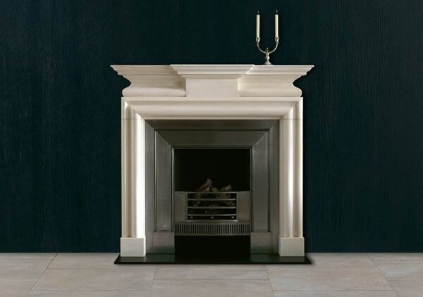 The Leverton - A mid 18th century chimneypiece in statuary marble with breakfront corniced shelf and incorporating a bolection moulding framing the aperture beneath a semi barrel frieze with plain projecting centre tablet.