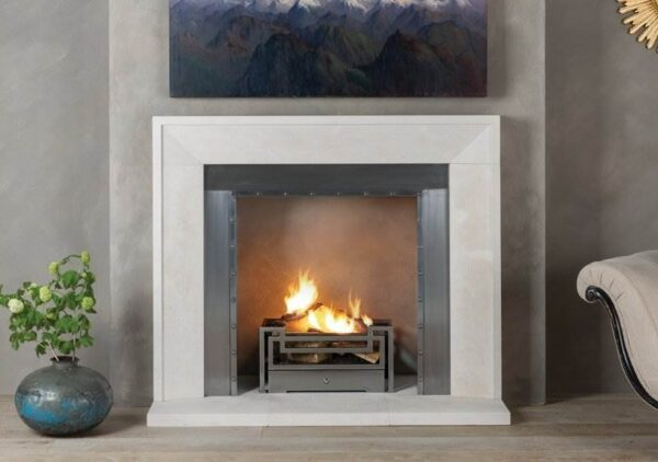 """The Metro - Simplicity is the cornerstone of this Chesneys modern fireplace. Elegant yet understated, The Metro is carved from the highest quality limestone to perfectly complement the aesthetics of both classic and contemporary interiors. With smooth architectural lines and straight, clean edging, this white fire surround will bring balance and proportion to a room of any size. Stage perfectly as an open fireplace, or couple with a?<a href=""""https://www.chesneys.co.uk/products/stoves/wood-burning"""">wood burning stove</a>?for added cosiness."""