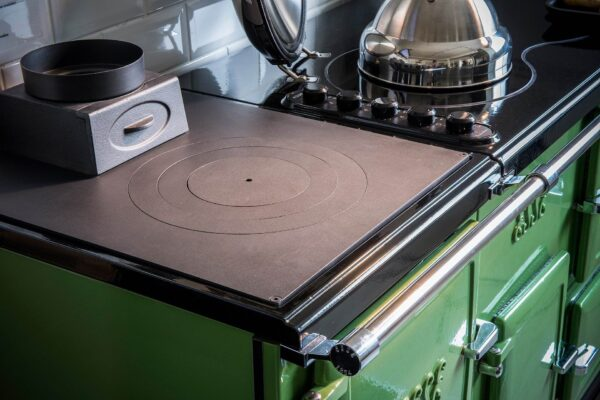 """Esse Plus 1 - This mini wood-burning range cooker has two aspects to its personality. It's ideal as a stand-alone unit in locations with limited space, and equally perfect as a partner to your ESSE electric or gas fired range – providing you with an extra oven, and a large """"target"""" hotplate."""