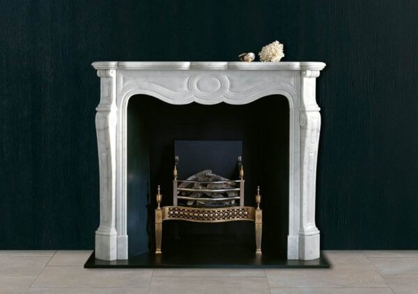 The Pompadour - A small French style marble chimneypiece of 18th century design having moulded panels to the frieze and jambs beneath a serpentine shelf.