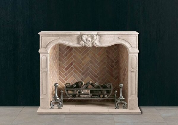 The Provencale - A serpentine fronted chimneypiece of the Louis XV period with carved central cartouche. Shown in Italian Bianco Avorio limestone.